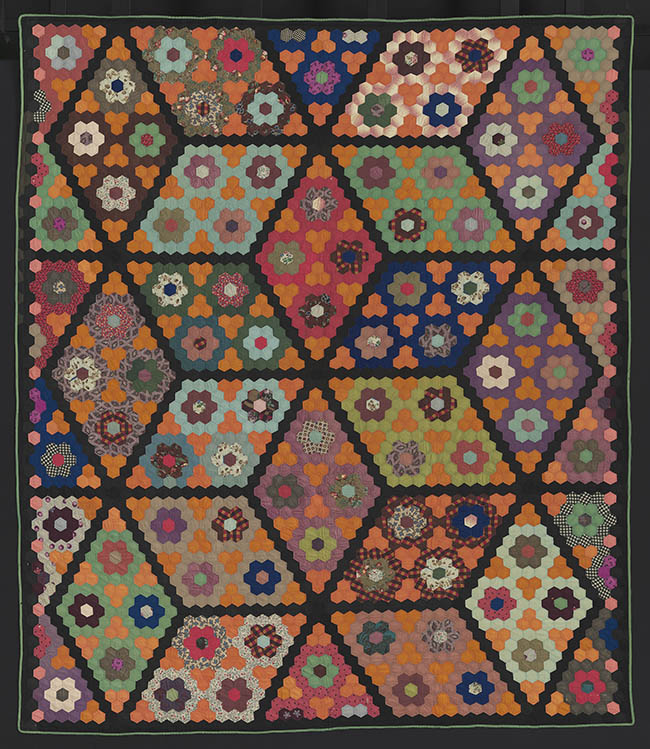 Field of Diamonds Quilt American, about 1860Pieced wool plain weave and twill (some printed), glazed cotton plain weave back, wool plain weave binding; quilted*Pilgrim / Roy Collection	*Courtesy, Museum of Fine Arts, Boston